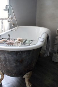 A beautiful old claw foot tub in a window