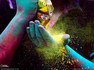 colors are loaded into a palm of a hand for Holi