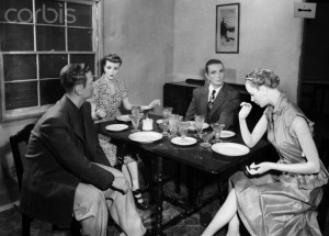 Nevada, USA --- Original caption: 3/15/1953-Atomic Test Site, NV: This casual dinner scene will take place in an average American home located 1 & 3/4 miles from where an atomic bomb is scheduled to explode on Mar. 17. The nodels in the photo in the photo are some of the many mannequins that will be used in frame houses, old and new cars, and experimental shelters. (Complete caption in Neg Sleeve). --- Image by © Bettmann/CORBIS